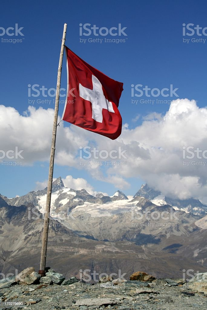 Swiss Flag Flying and Mountain Landscape royalty-free stock photo