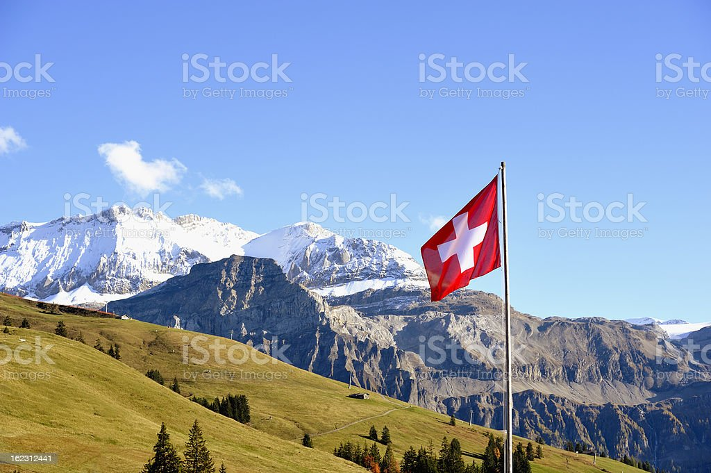 Swiss Flag in Front of Bernese Alps Panorama royalty-free stock photo
