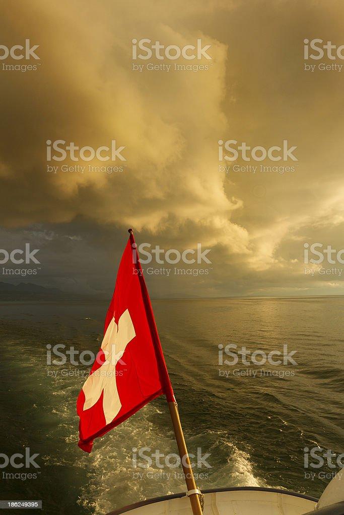 Swiss flag on boat. Lake Leman stock photo