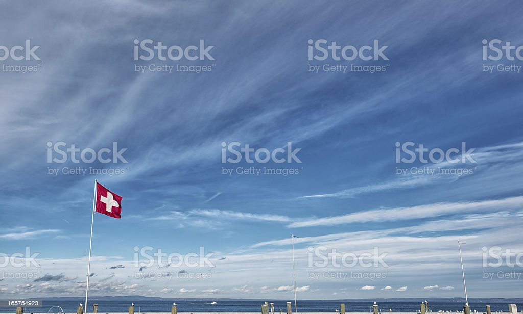swiss flag over lake constance at harbour Rorschach royalty-free stock photo