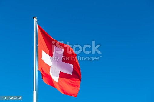 Swiss flag and clear blue sky