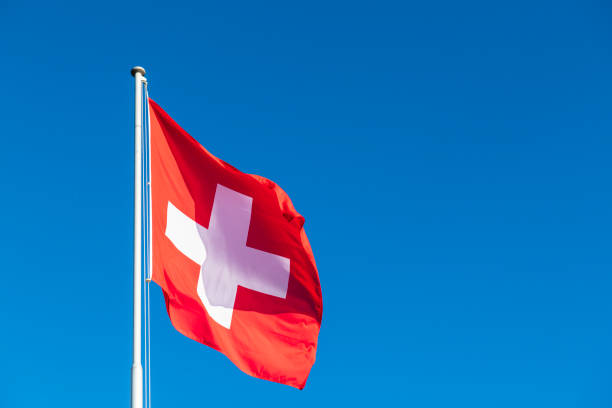 Swiss flag Swiss flag and clear blue sky swiss culture stock pictures, royalty-free photos & images