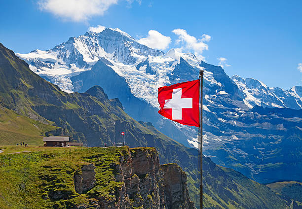 Swiss flag Swiss flag on the top of Mannlichen (Jungfrau region, Bern, Switzerland) switzerland stock pictures, royalty-free photos & images