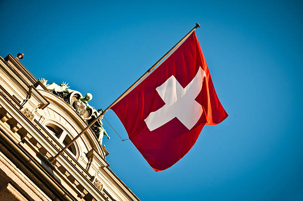swiss flag waving on historic building swiss flag waving on historic building switzerland stock pictures, royalty-free photos & images