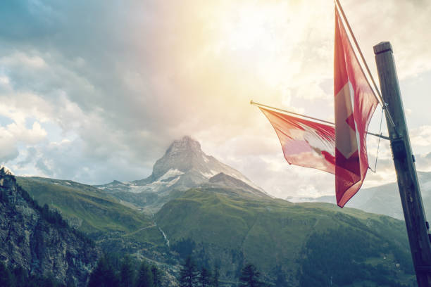 Swiss flag with Matterhorn, Zermatt, Swiss Alps, Switzerland stock photo