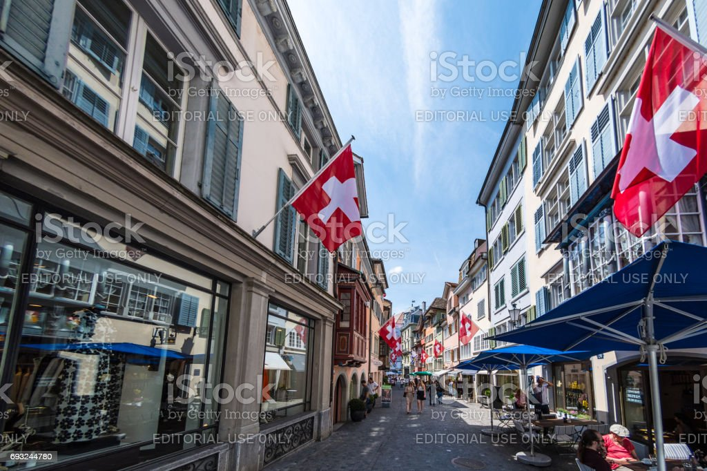 Swiss flags on shopping street in old town Zurich stock photo