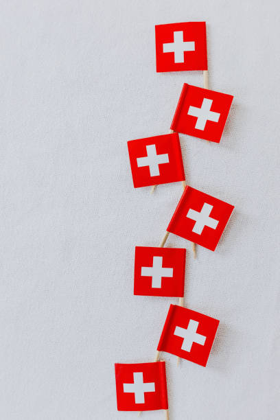Swiss flags on wooden toothpicks used to decorate the traditional swiss bread baked on Swiss National Day on August 1st. White background, isolated, copy space. Swiss flags on wooden toothpicks used to decorate the traditional swiss bread baked on Swiss National Day on August 1st. White background, isolated, copy space. annually stock pictures, royalty-free photos & images