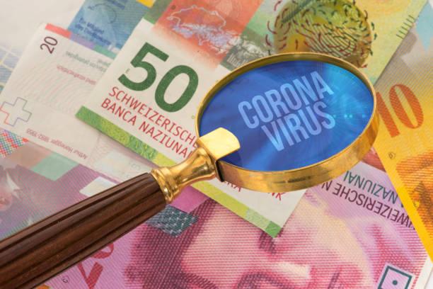 Swiss franc and coronavirus in Switzerland stock photo