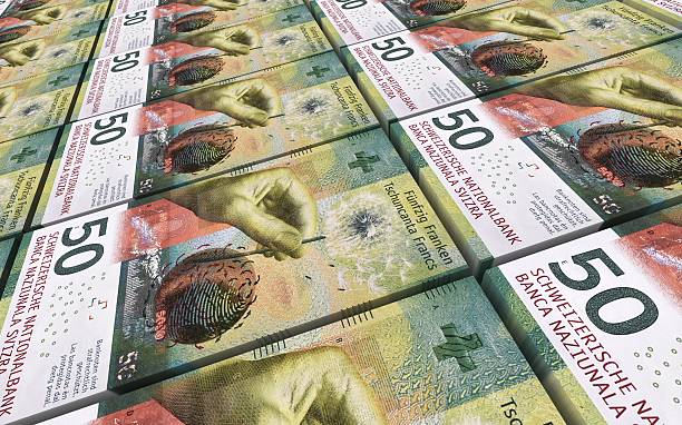 swiss franc bills stacks background. - franken stockfoto's en -beelden