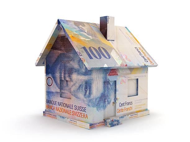 swiss franc real estate house money concept - franken stockfoto's en -beelden