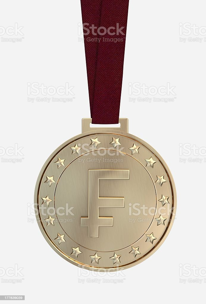 Swiss Franc sing on gold medal royalty-free stock photo