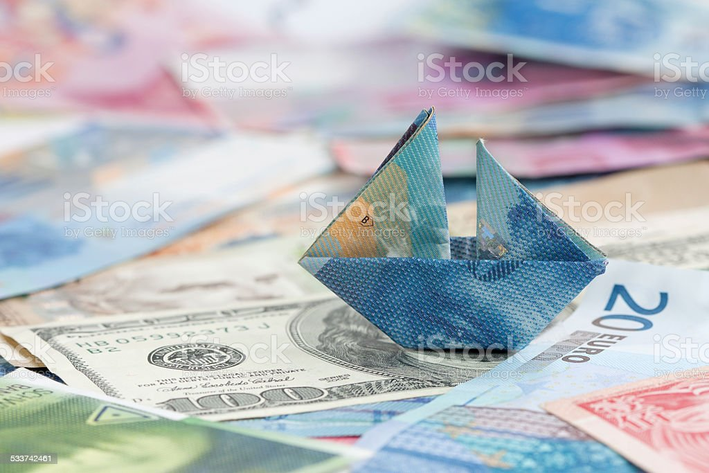 Swiss france folded as boat on world currencies stock photo
