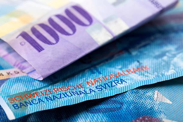 swiss francs close-up - franken stockfoto's en -beelden
