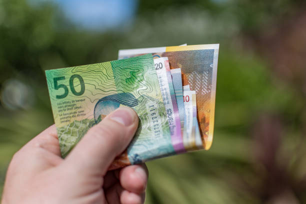 Swiss Francs (CHF) paper currency outdoors stock photo