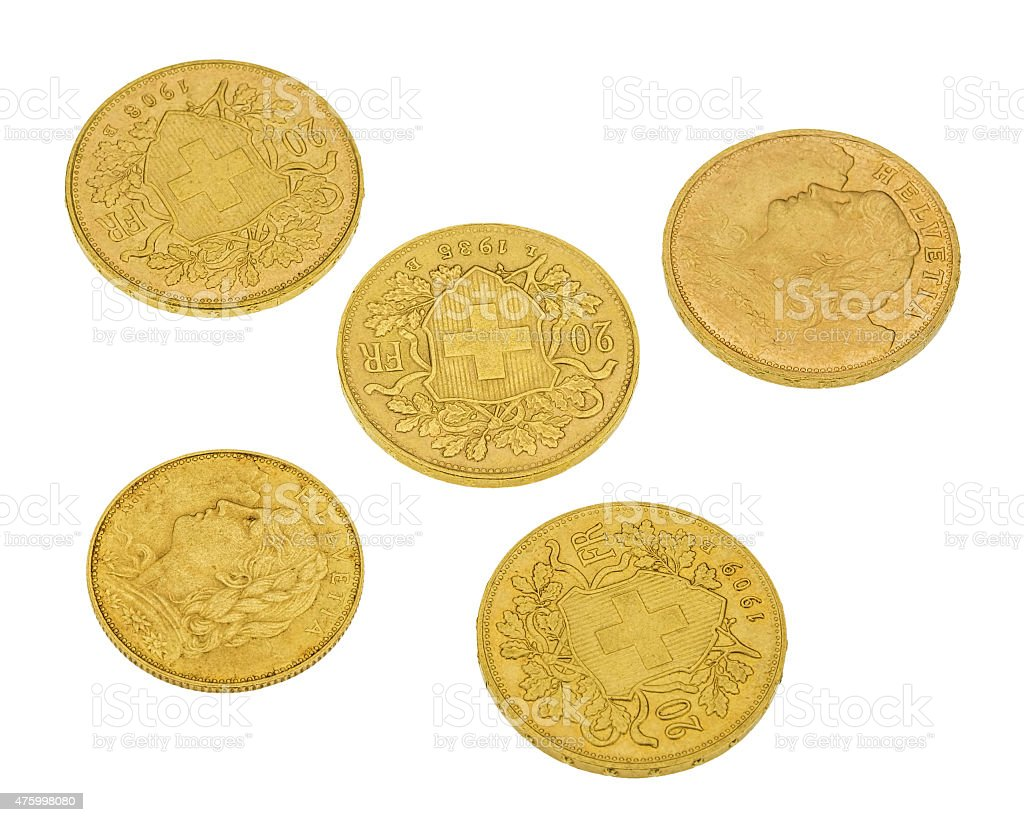 Swiss gold coins isolated on white stock photo