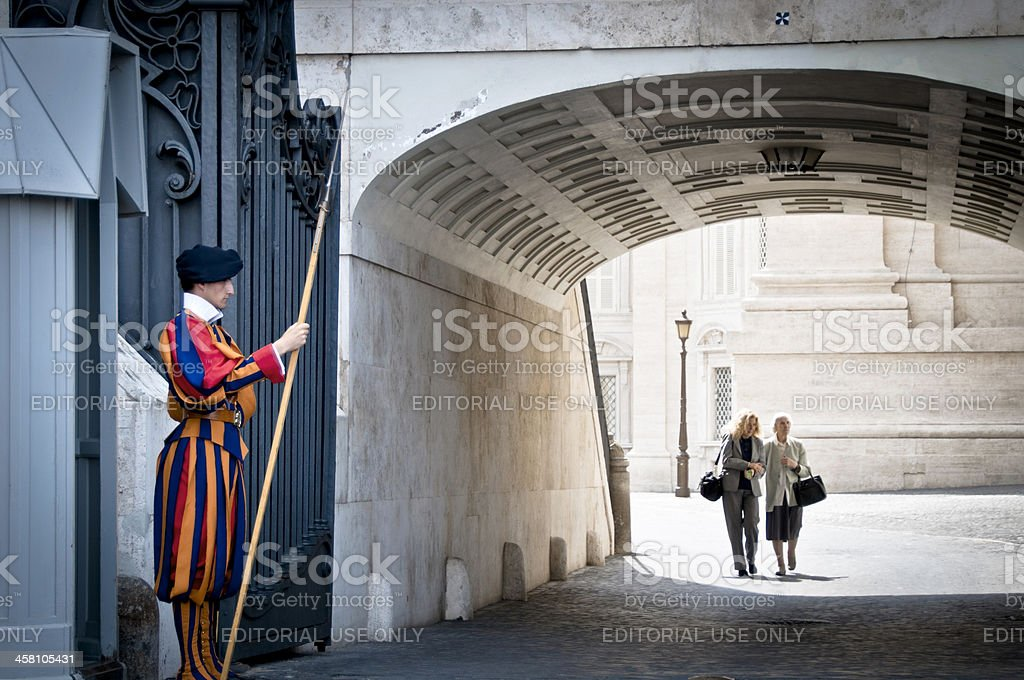 Swiss guard stands at an entrance of the Vatican royalty-free stock photo