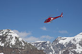 Zermatt, Switzerland - April 13, 2017: A red rescue helicopter in the Swiss Alps