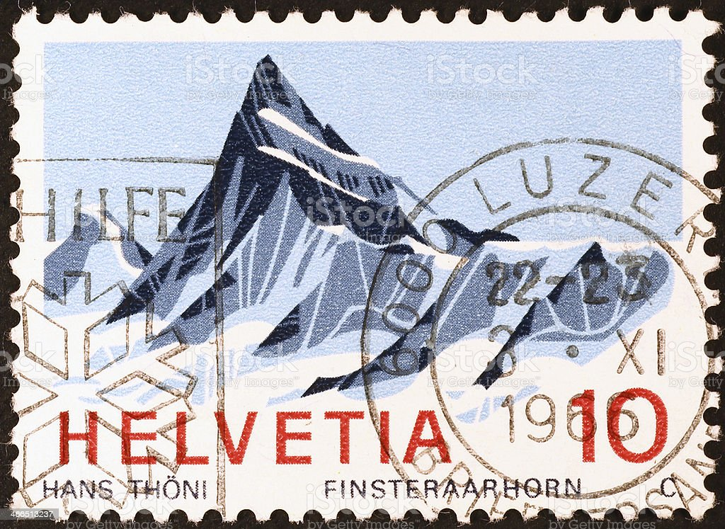 Swiss mountain on a cancelled stamp royalty-free stock photo