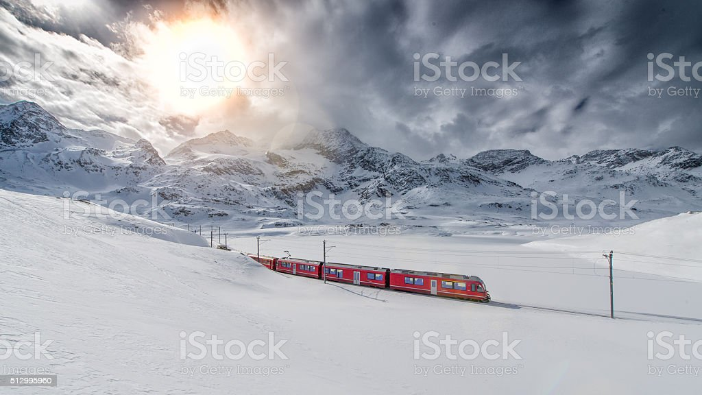 Swiss mountain train Bernina Express crossed through the high mo stock photo