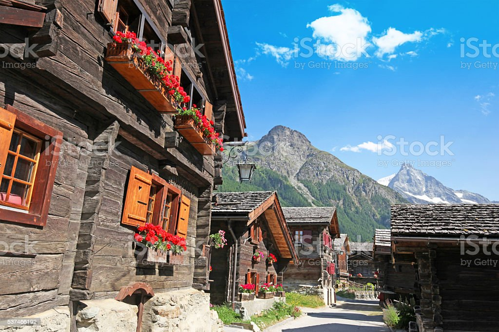 Swiss Mountain Village and Charming Old Chalets in Summer stock photo