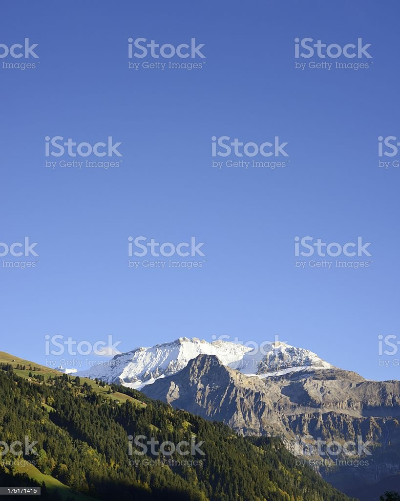 Swiss Mountains and Green Hills stock photo