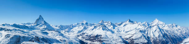Swiss Mountains Panorama High Resolution Panorama shot of the Swiss alps, including the famous Matterhorn swiss alps stock pictures, royalty-free photos & images