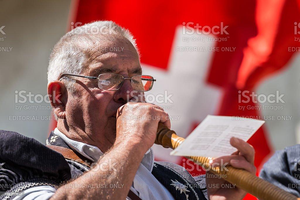Swiss musician on the cheese festival in Gruyere, Switzerland. stock photo