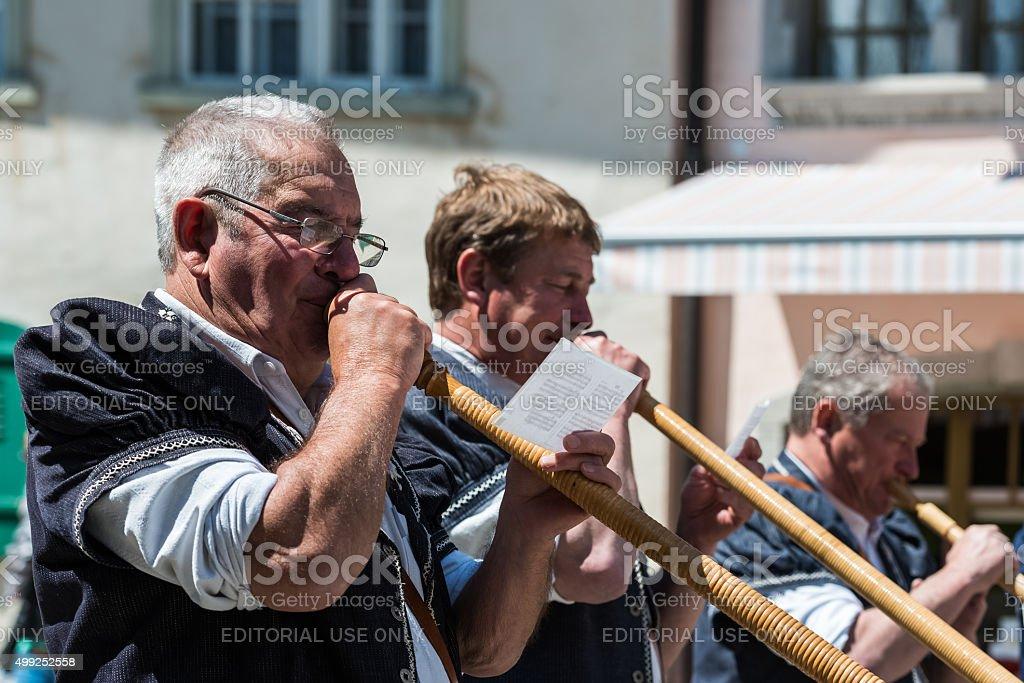 Swiss musicians on the cheese festival in Gruyere, Switzerland. stock photo