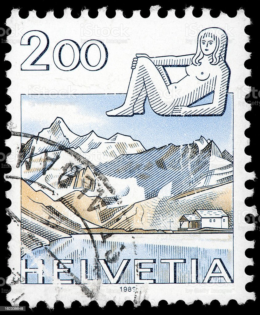 Swiss Postage Stamp,  Snowy Mountain Valley  with Helvetia, Switzerland stock photo