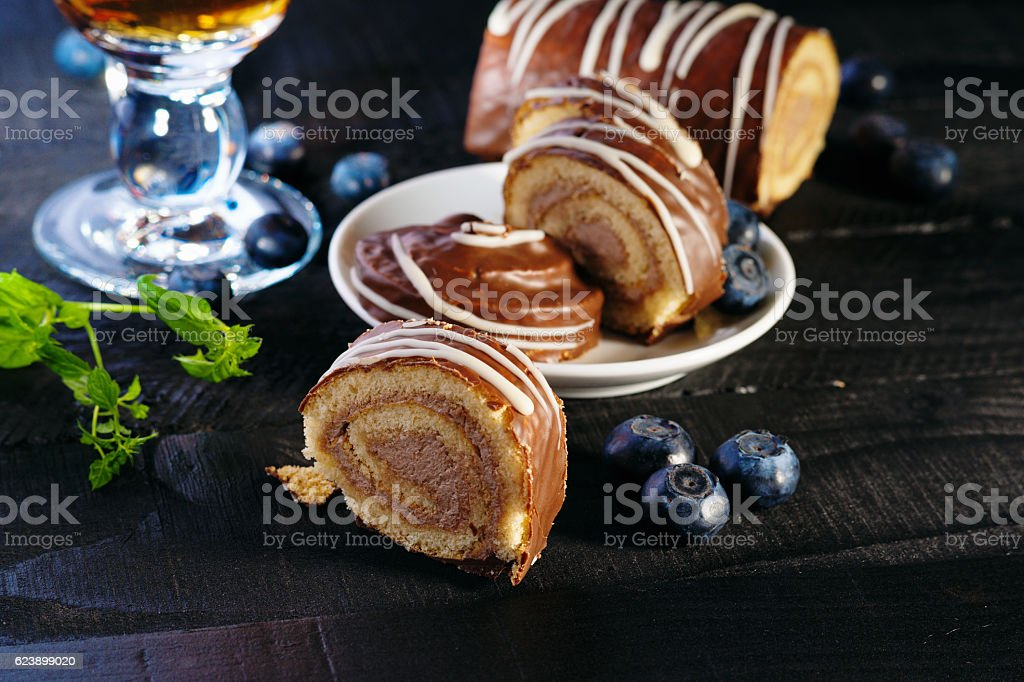 Swiss roll, blueberry and tea stock photo