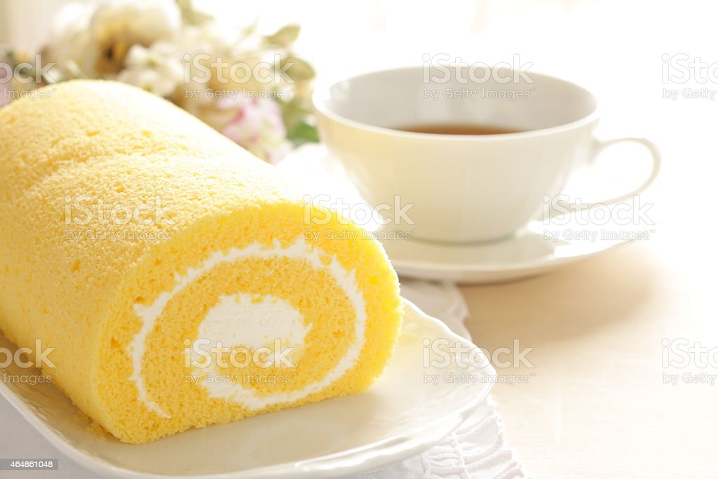 swiss roll served with English tea stock photo