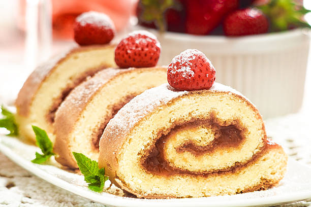 Swiss roll with strawberry stock photo