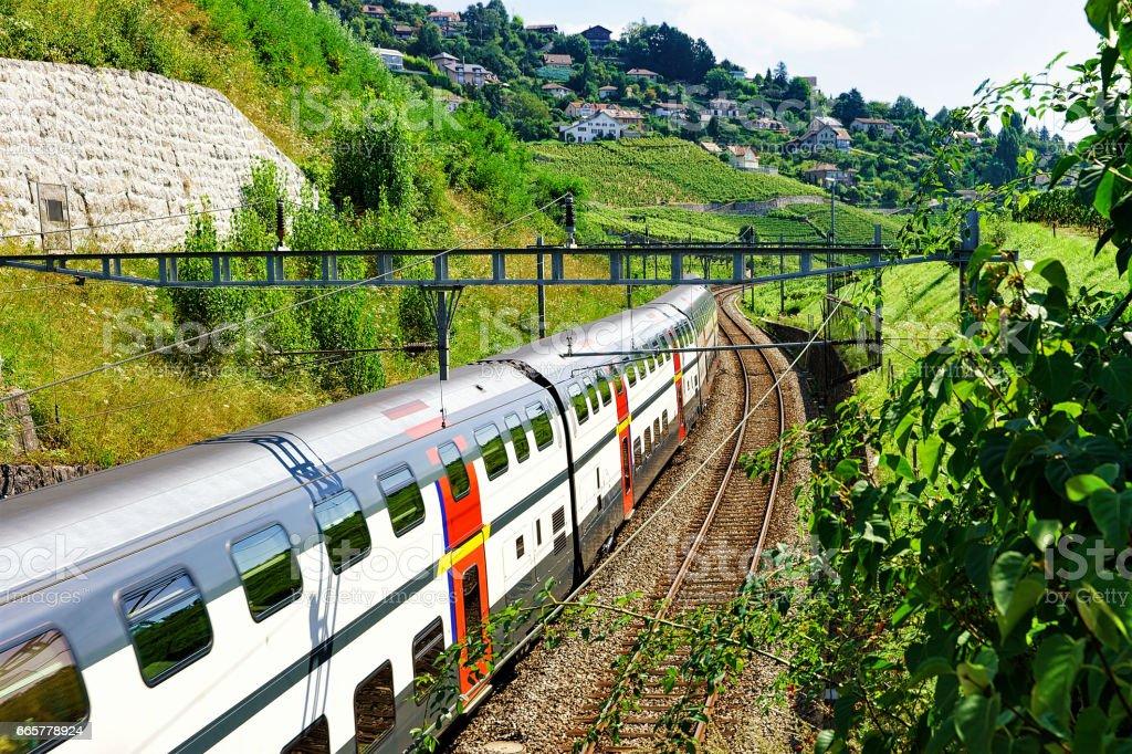 Swiss running train at Vineyard Terraces of Lavaux of Switzerland stock photo