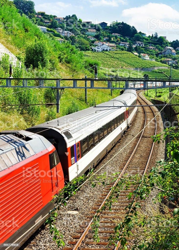 Swiss running train in Vineyard Terrace of Lavaux of Switzerland stock photo