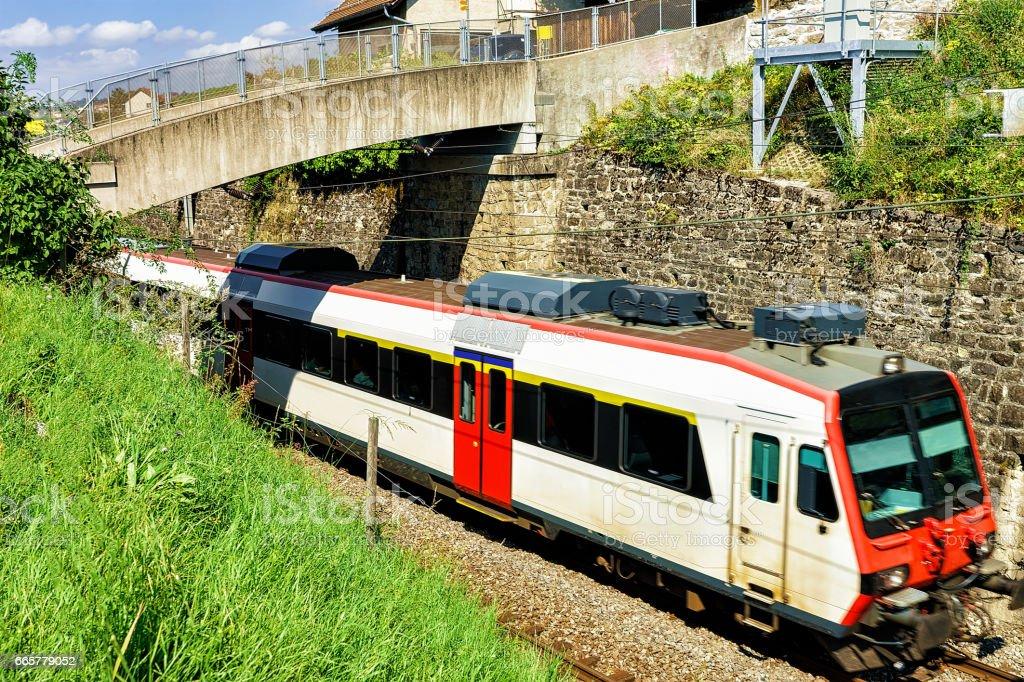 Swiss running train in Vineyard Terrace of Lavaux Switzerland stock photo