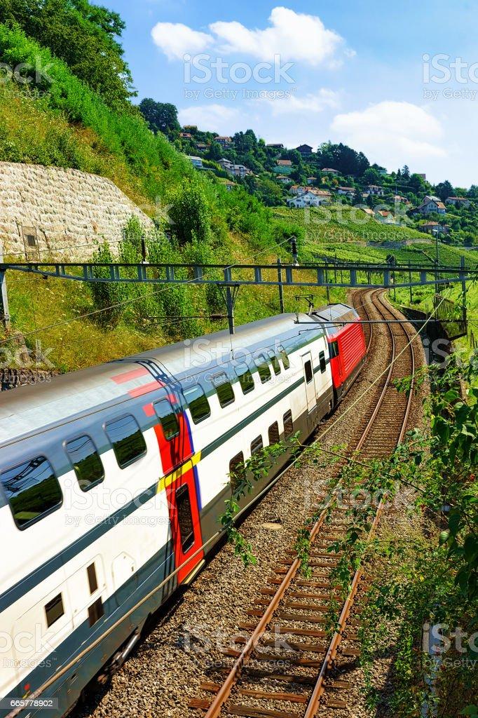 Swiss running train in Vineyard Terraces of Lavaux of Switzerland stock photo