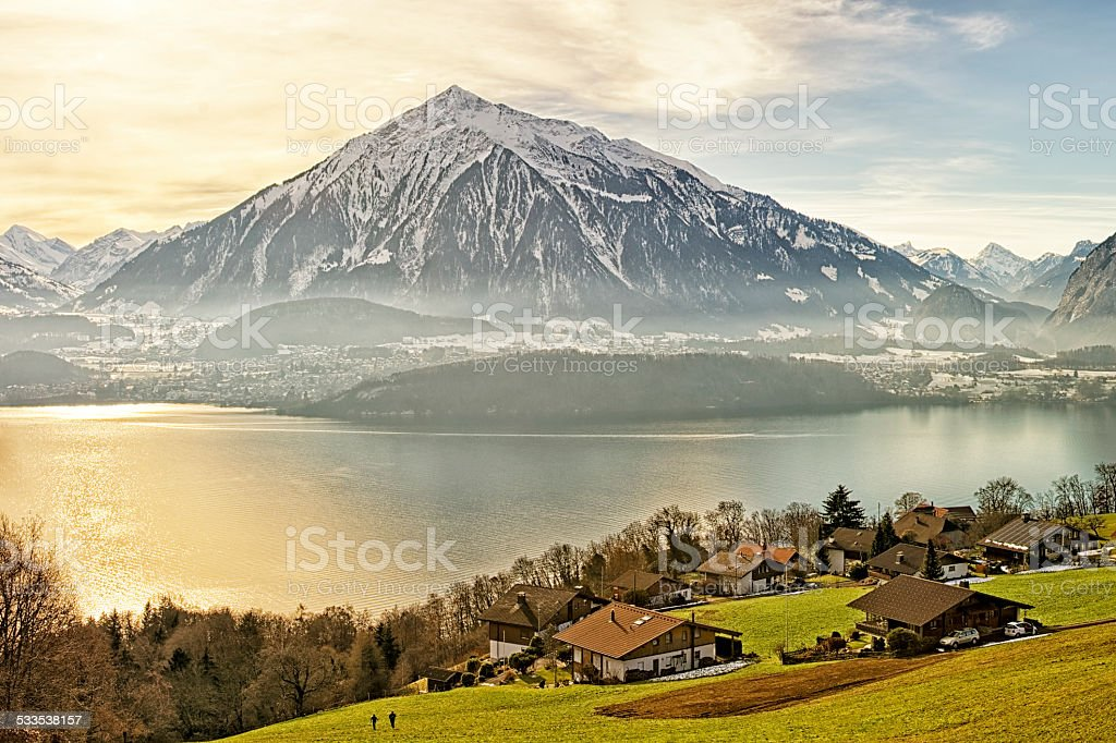 Swiss rural landscape near Thun lake at sunshine stock photo