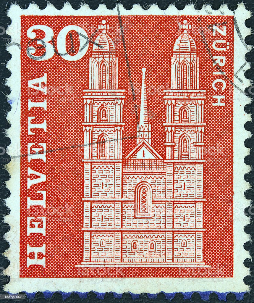 Swiss stamp shows Grossmunster church, Zurich (1960) royalty-free stock photo