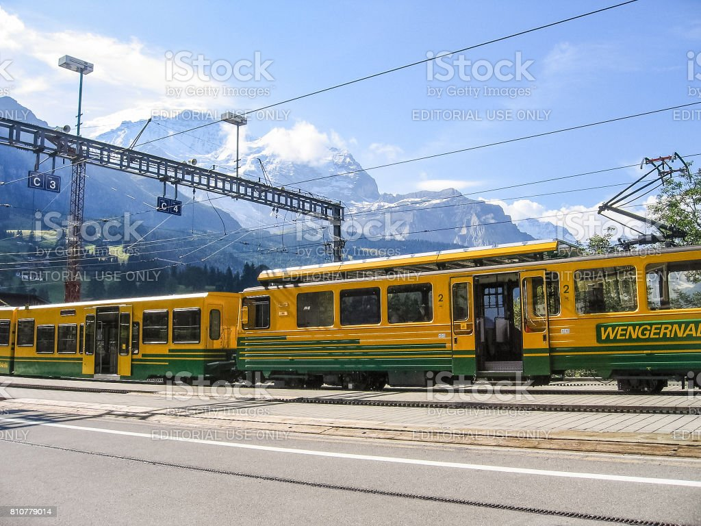 Swiss train during summer with alpine landscape in mountains stock photo