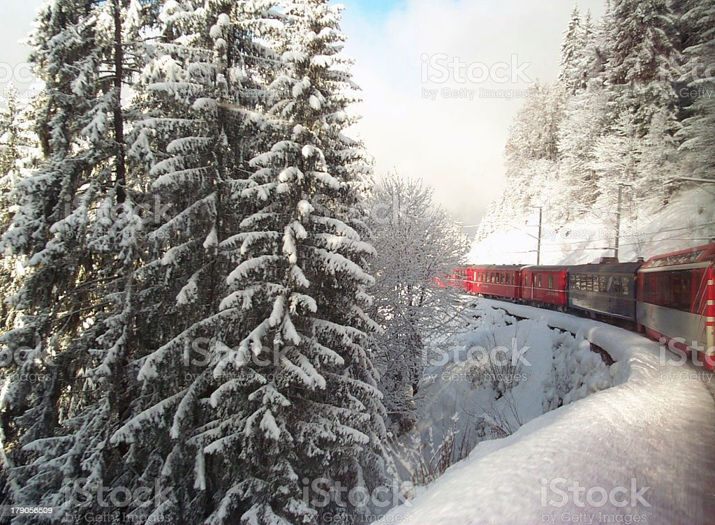 Swiss Train Travelling through Alps in Winter stock photo