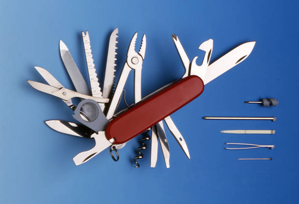 swiss universal knife with its tools - swiss army knife imagens e fotografias de stock