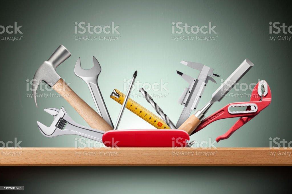 Swiss universal knife with tools on shelf stock photo
