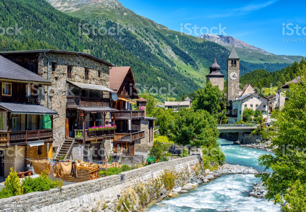 Swiss village in Alps mountains, Grisons, Switzerland royalty-free stock photo