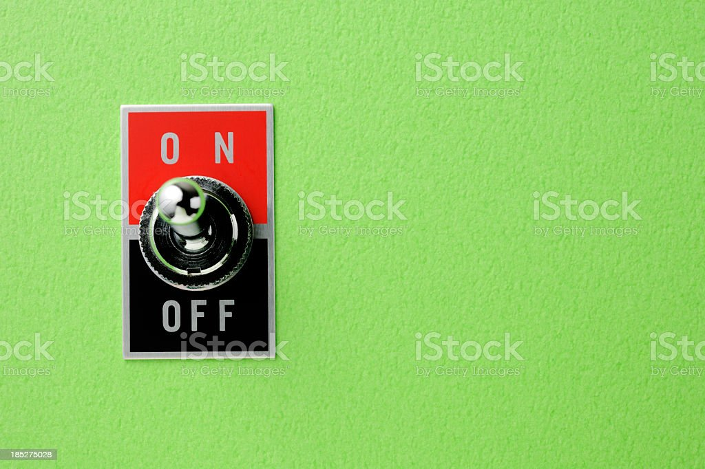 ON OFF switch on green wall with copy space stock photo