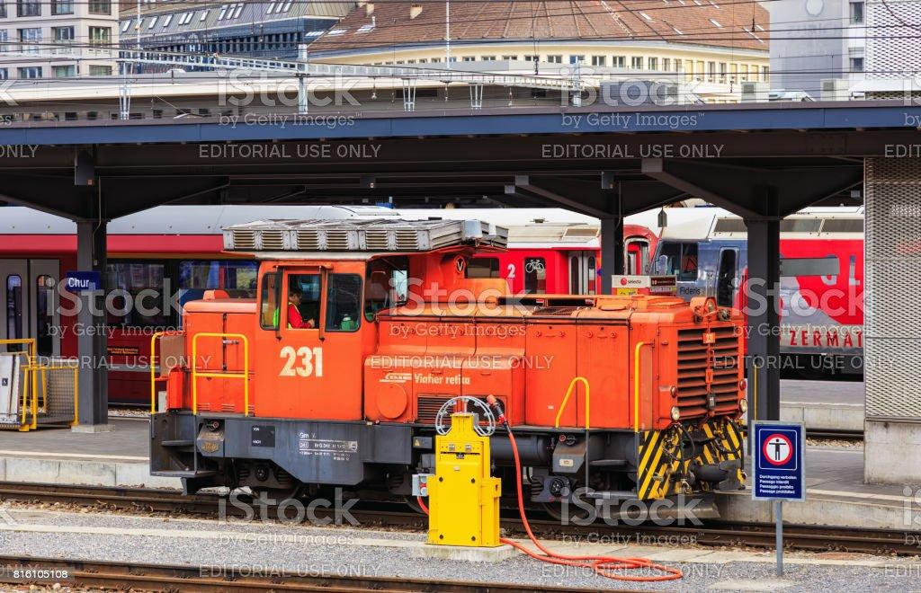 A switcher locomotive of the Rhaetian Railway at the Chur railway station in Switzerland stock photo