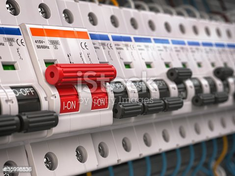 istock Switches in fusebox. Many black circuit brakers in a row in position OFF and one red switch in position ON. 835998836