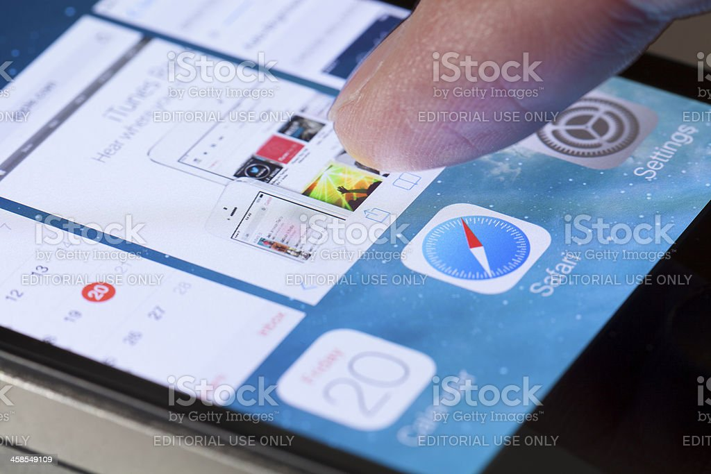 Switching between apps in iOS 7 royalty-free stock photo