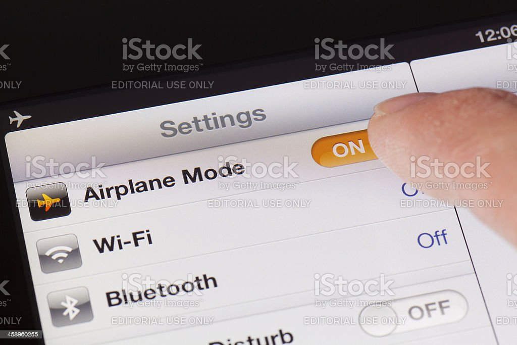 Switching to Airplane mode on a new ipad with iOS6 royalty-free stock photo