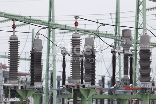 Electrical switchyard used for voltage distribution close up photography.