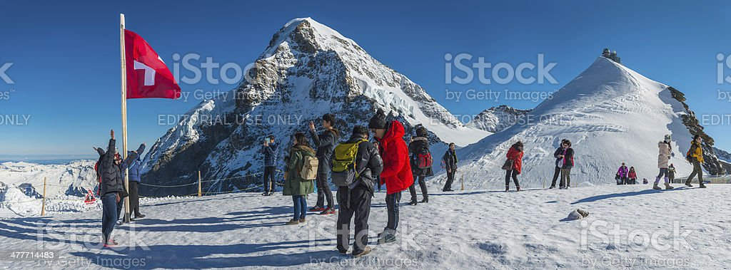Switzerland Alps Japanese tourists enjoying winter mountain sunshine Sphinx Jungfraujoch stock photo